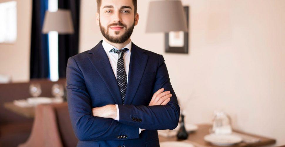 confident-handsome-businessman-in-restaurant-RZHFMVN.jpg